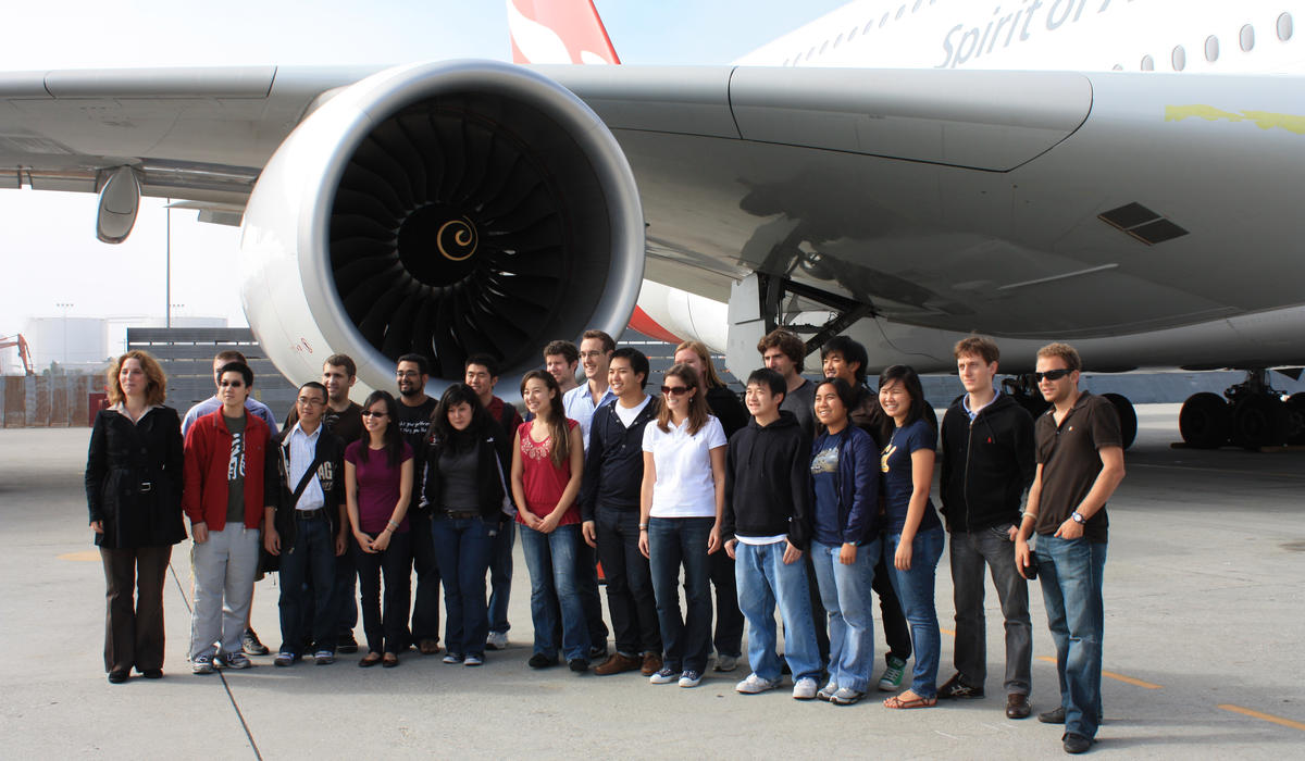 Class photo with airplane