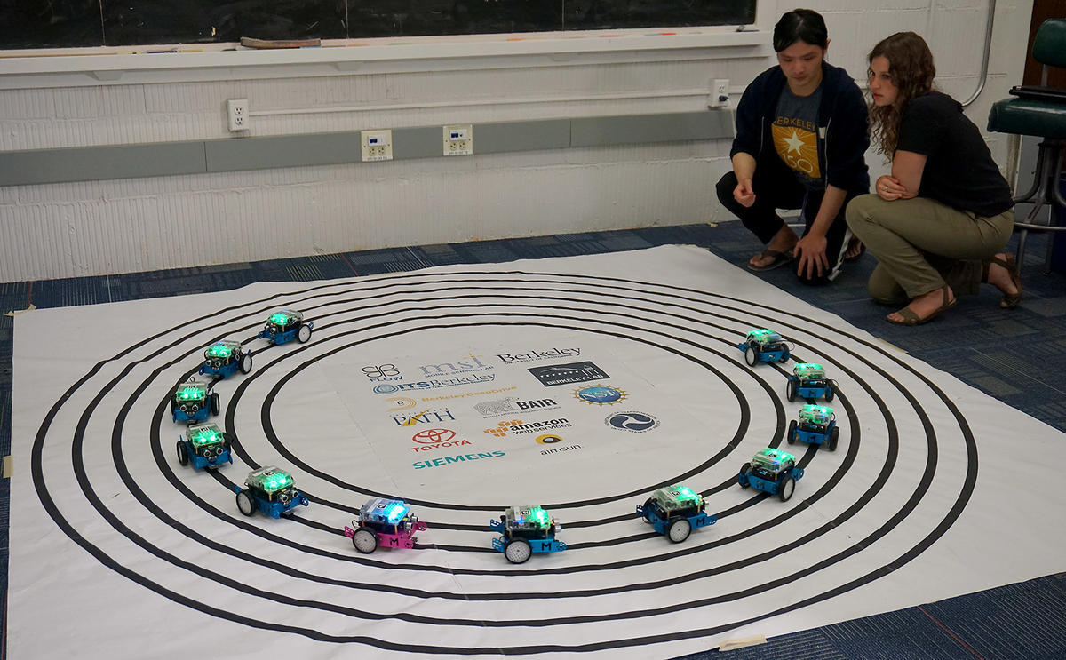 Doctoral students Jessica Lazarus and Fangyu Wu test placing an autonomous pace car in a circle of traffic.