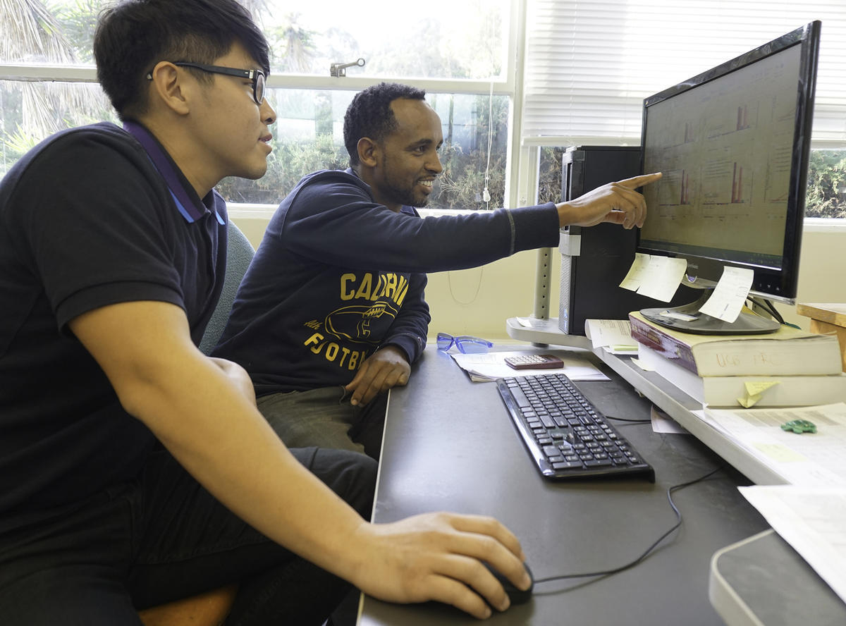 Two students working on a computer